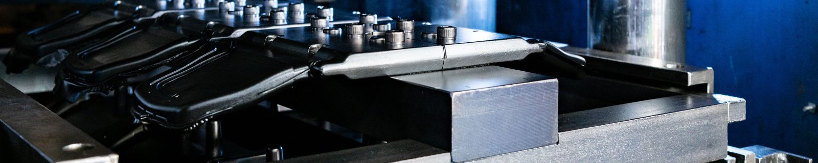 Rubber to metal bonding of overmoulded parts